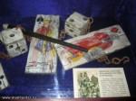 Ожерелье с картами, игральными костями и трубками